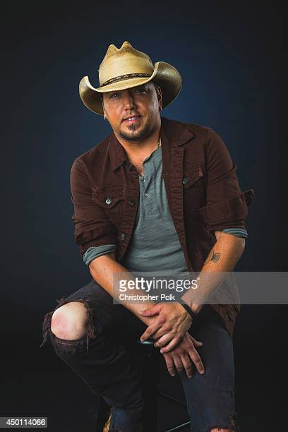 Jason Aldean poses at the 2014 CMT Music Awards Wonderwall Portrait Studio at Bridgestone Arena on June 4 2014 in Nashville Tennessee