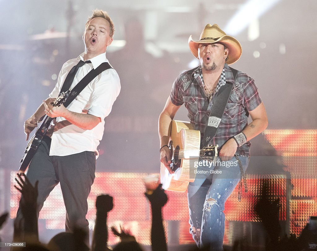 Jason Aldean, right, and guitarist Kurt Allison perform at Fenway Park on Friday, July 12, 2013.
