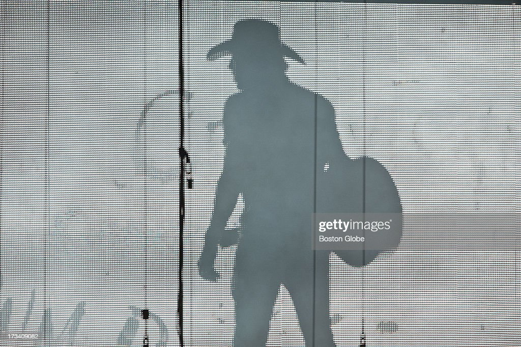Jason Aldean's image on the large video screen onstage, moments before being introduced to his fans at Fenway Park, Friday, July 12, 2013.