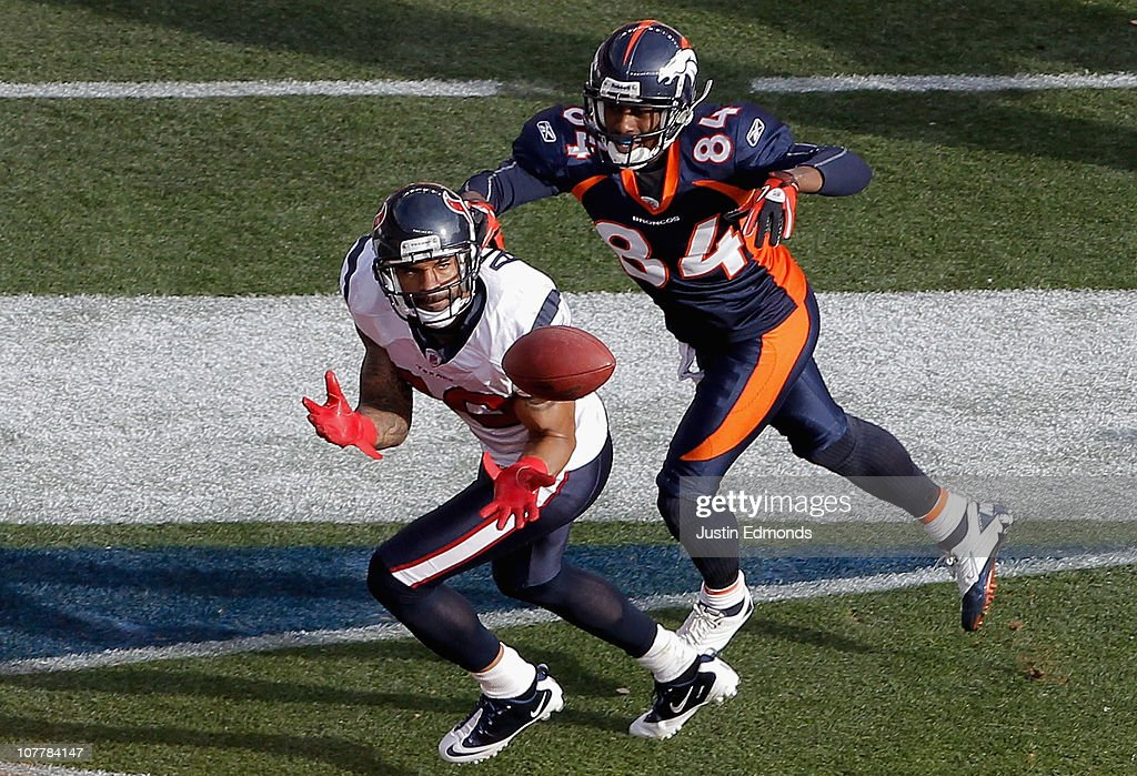 Jason Allen #30 of the Houston Texans intercepts a pass in the end zone intended for Brandon Lloyd #84 of the Denver Broncos during the first quarter at INVESCO Field at Mile High on December 26, 2010 in Denver, Colorado.