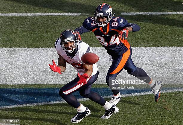 Jason Allen of the Houston Texans intercepts a pass in the end zone intended for Brandon Lloyd of the Denver Broncos during the first quarter at...