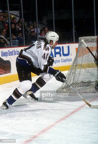 Jason Allison of the Washington Capitals skates with the puck during an NHL game in January 1996 at the USAir Arena in Landover Maryland