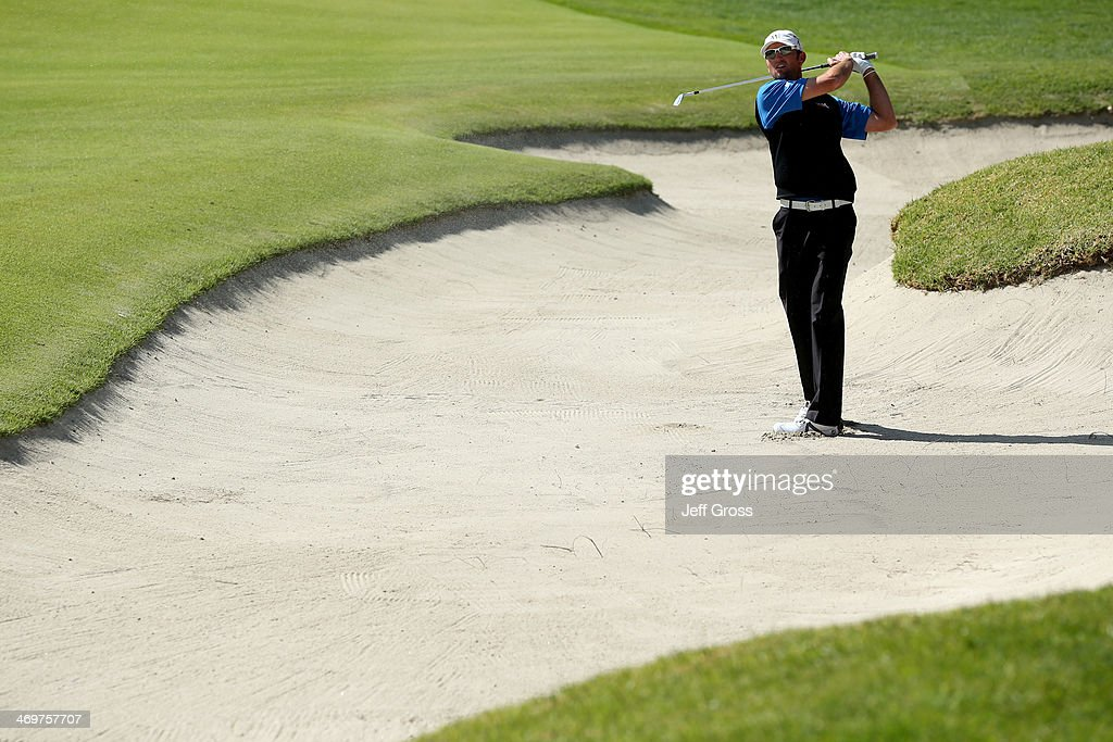 Jason Allred hits a shot out of a bunker on the 7th hole in the final round of the Northern Trust Open at the Riviera Country Club on February 16...