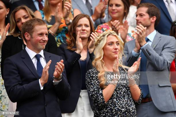 Jason and Laura Kenny applaud from the centre court royal box on day six of the Wimbledon Lawn Tennis Championships at the All England Lawn Tennis...