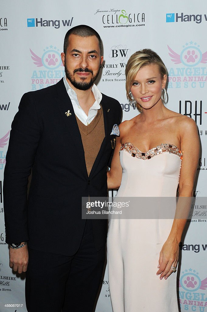 Jason Arasheben (L) and Joanna Krupa arrive at the Beverly Wilshire Four Seasons Hotel for Angels For Animal Rescue benefit hosted by Joanna Krupa on December 10, 2013 in Beverly Hills, California.
