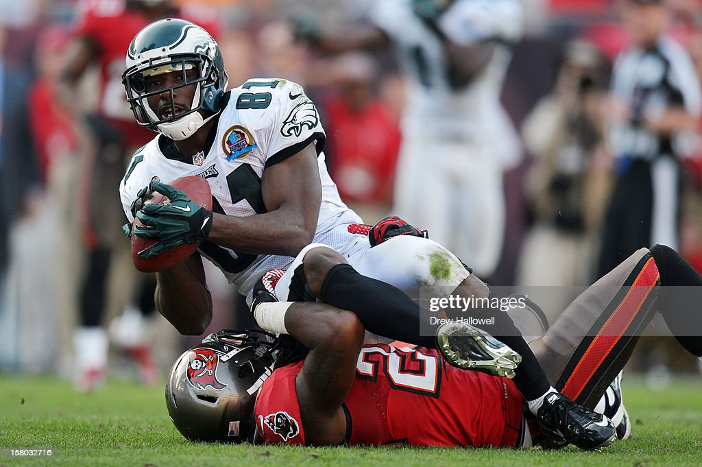 Jason Avant #81 of the Philadelphia Eagles catches a pass and is stopped short of the goal line by Mark Barron #24 of the Tampa Bay Buccaneers at Raymond James Stadium on December 9, 2012 in Tampa, Florida. The Eagles won 23-21.
