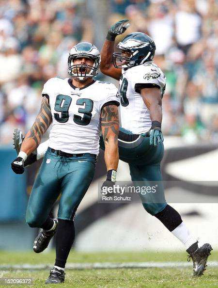 Jason Babin and DeMeco Ryans of the Philadelphia Eagles react to Ryans sack of quarterback Joe Flacco of the Baltimore Ravens during a game at...