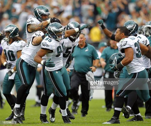 Jason Babin Casey Matthews Mychal Kendricks DeMeco Ryans and Stanley Havili of the Philadelphia Eagles celebrate their 2423 win over the Baltimore...