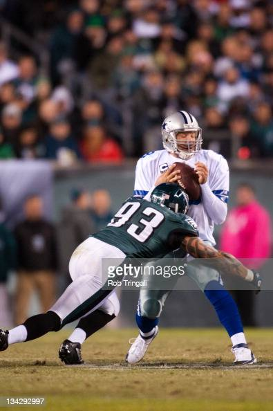Jason Babin of the Philadelphia Eagles sacks Tony Romo of the Dallas Cowboys during the game between the Philadelphia Eagles and the Dallas Cowboys...