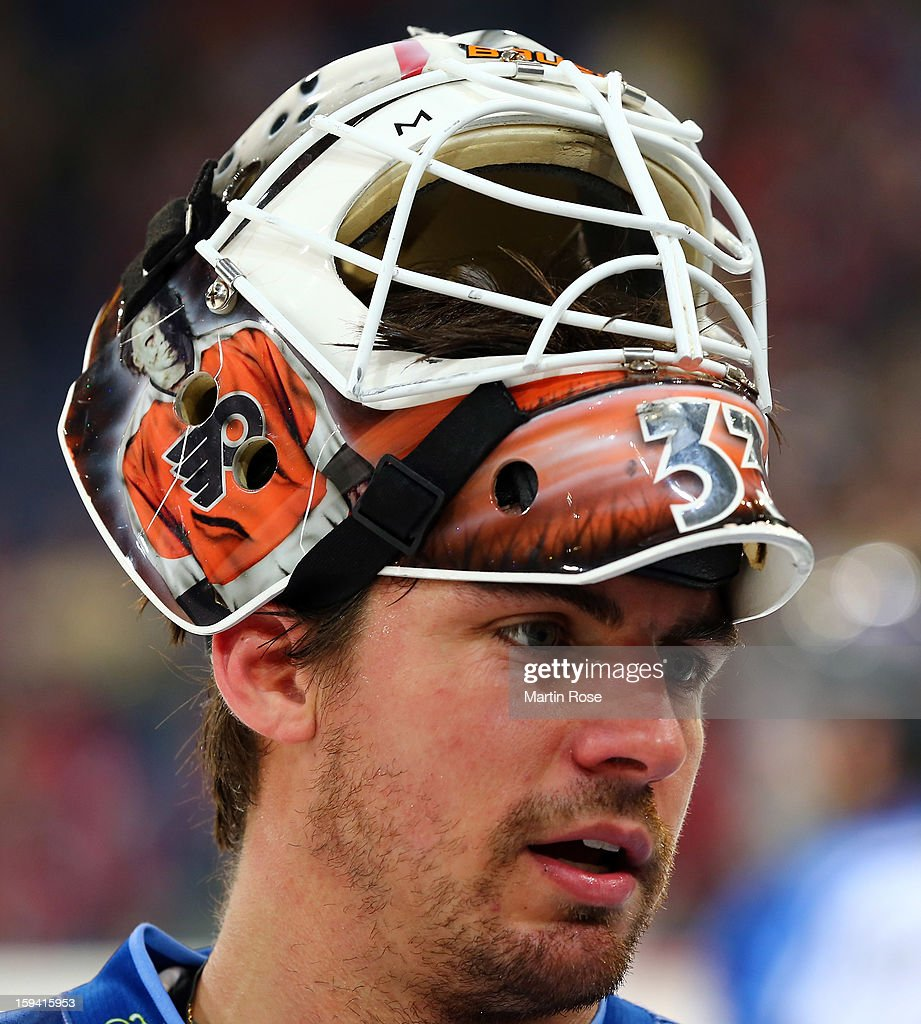 Jason Bacashihua, goaltender of Straubing looks dejected during the DEL match between Hannover Scorpions and Straubing Tigers at TUI Arena on January 13, 2013 in Hanover, Germany.
