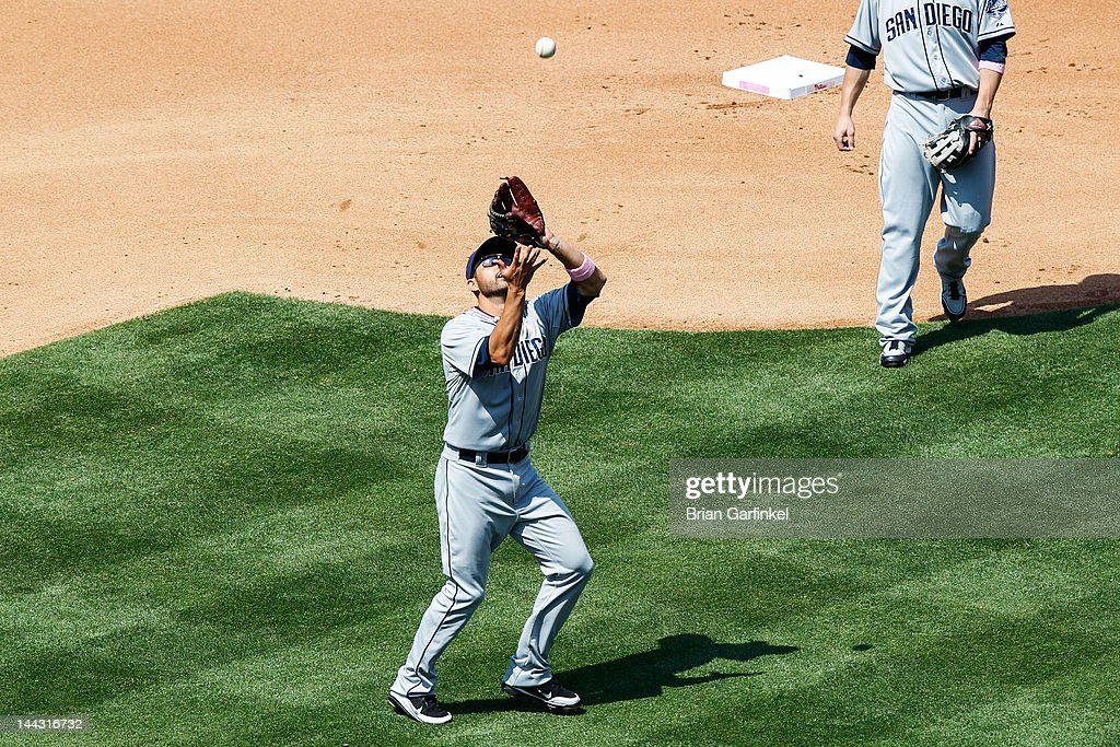 <a gi-track='captionPersonalityLinkClicked' href=/galleries/search?phrase=Jason+Bartlett&family=editorial&specificpeople=542737 ng-click='$event.stopPropagation()'>Jason Bartlett</a> #8 of the San Diego Padres catches a fly ball in the fourth inning of the game against the Philadelphia Phillies at Citizens Bank Park on May 13, 2012 in Philadelphia, Pennsylvania.