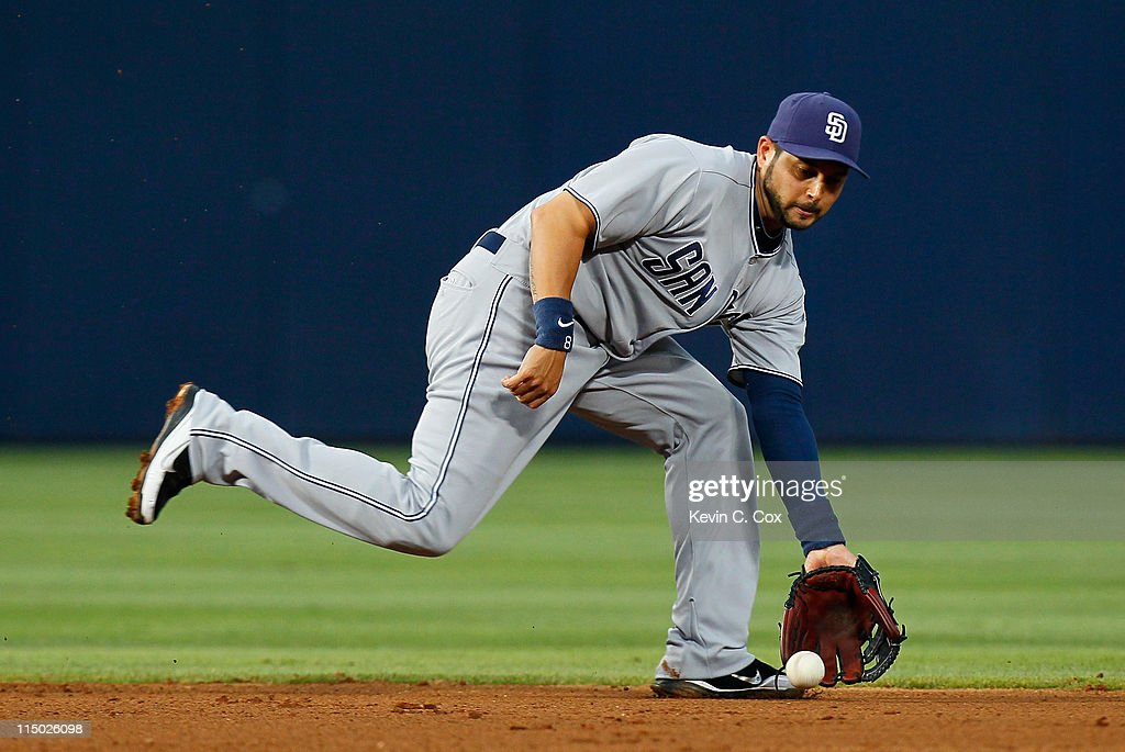 <a gi-track='captionPersonalityLinkClicked' href=/galleries/search?phrase=Jason+Bartlett&family=editorial&specificpeople=542737 ng-click='$event.stopPropagation()'>Jason Bartlett</a> #8 of the San Diego Padres scoops up a ground ball hit by Jordan Schafer #1 of the Atlanta Braves in the fourth inning at Turner Field on June 1, 2011 in Atlanta, Georgia.