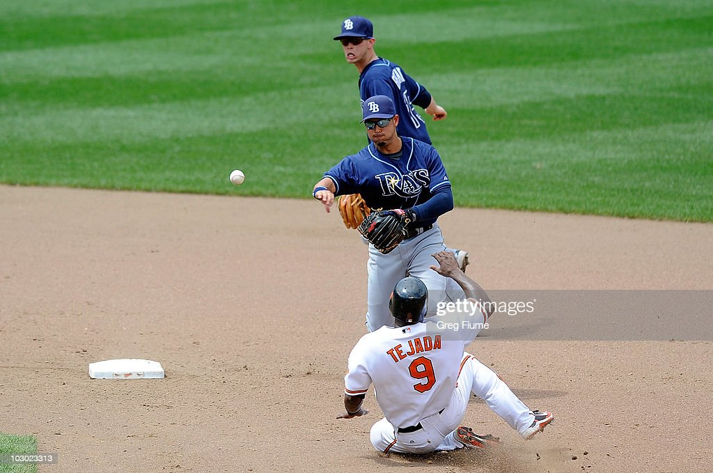 Jason Bartlett of the Tampa Bay Rays forces out Miguel Tejada of the Baltimore Orioles to start a double play at Camden Yards on July 21 2010 in...