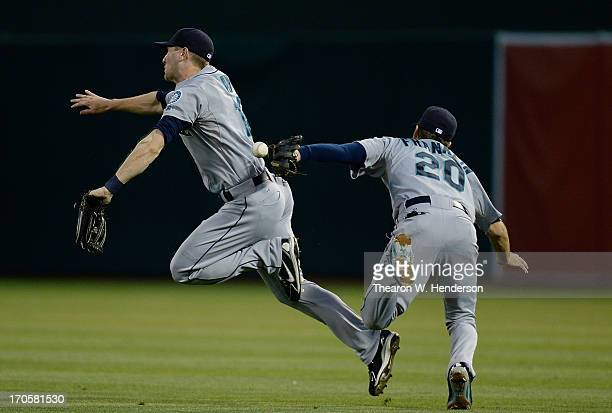 Jason Bay and Nick Franklin of the Seattle Mariners avoid colliding with each other while missing a short fly ball that went for an RBI double off...