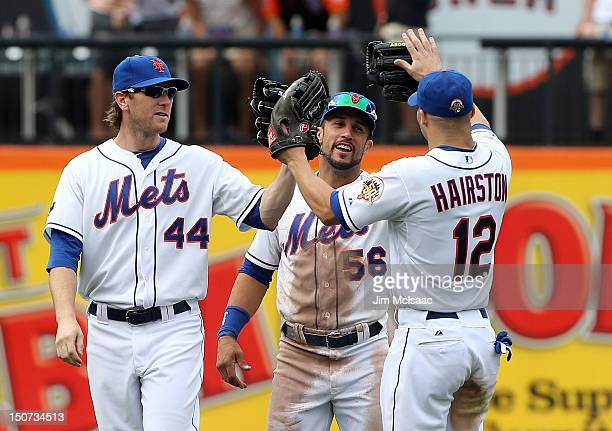 Jason Bay Andres Torres and Scott Hairston of the New York Mets celebrate after defeating the Houston Astros at Citi Field on August 25 2012 in the...