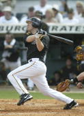 Jason Bay of the Pittsburgh Pirates hits a home run against the Tampa Bay Devil Rays on March 12 2006 at McKechnie Field in Bradenton Florida