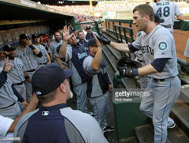 Jason Bay of the Seattle Mariners is congratulated by his team mates for hitting a solo home run in the first inning against the Texas Rangers at...