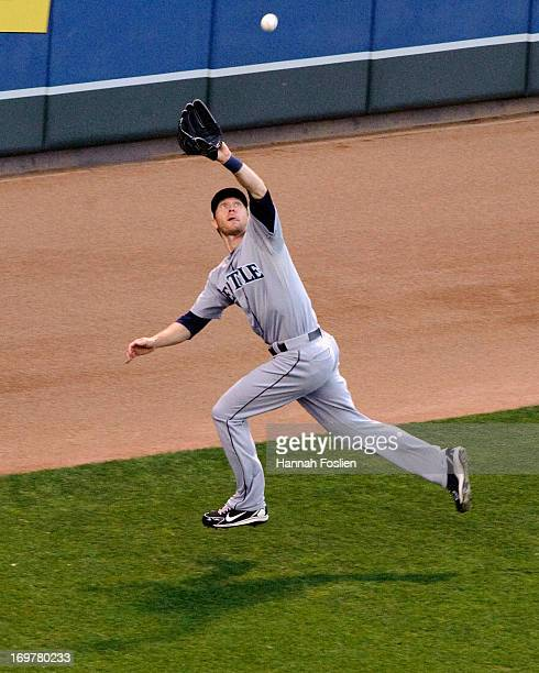 Jason Bay of the Seattle Mariners makes a catch in left field for an out during the fifth inning of the game against the Minnesota Twins on June 1...