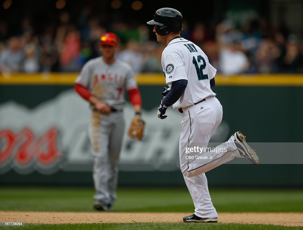 <a gi-track='captionPersonalityLinkClicked' href=/galleries/search?phrase=Jason+Bay&family=editorial&specificpeople=214251 ng-click='$event.stopPropagation()'>Jason Bay</a> #12 of the Seattle Mariners rounds the bases after hitting a home run in the seventh inning against the Los Angeles Angels of Anaheim at Safeco Field on April 28, 2013 in Seattle, Washington.