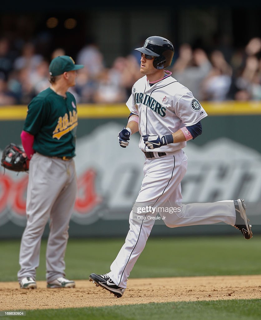 <a gi-track='captionPersonalityLinkClicked' href=/galleries/search?phrase=Jason+Bay&family=editorial&specificpeople=214251 ng-click='$event.stopPropagation()'>Jason Bay</a> #12 of the Seattle Mariners rounds the bases after hitting a home run in the seventh inning against the Oakland Athletics at Safeco Field on May 12, 2013 in Seattle, Washington. The Mariners defeated the Athletics 6-1.