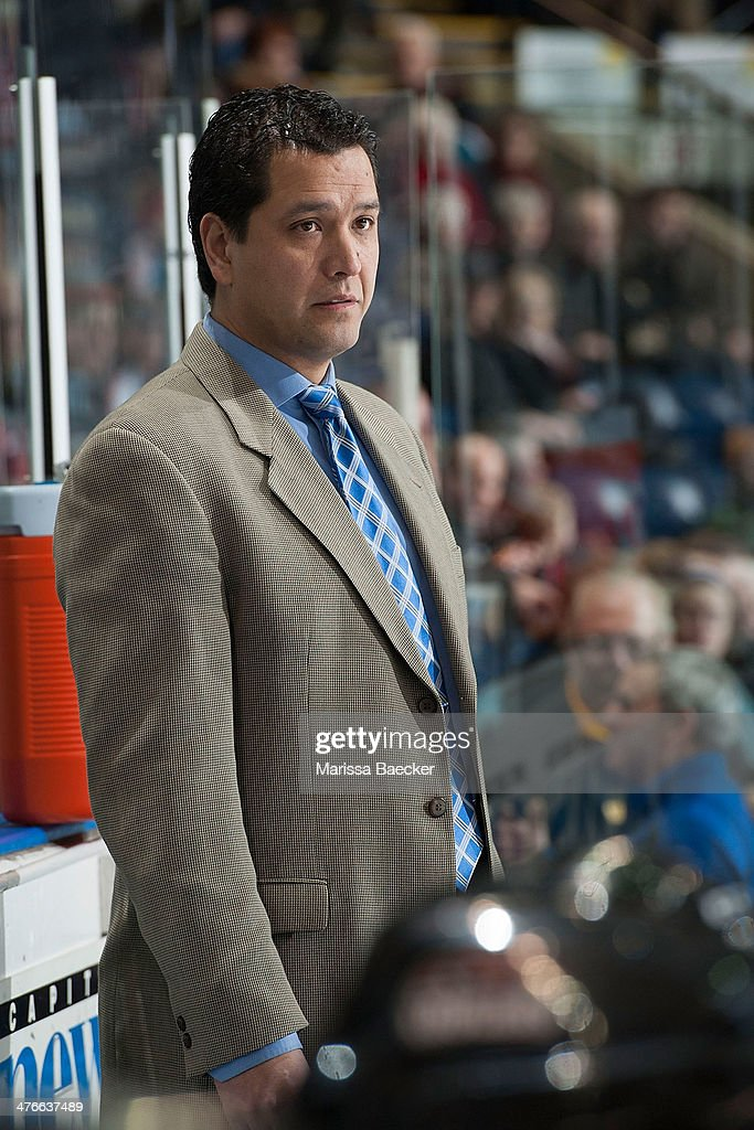 Jason Becker, assistant coach of the Prince George Cougars stands on the bench against the Kelowna Rockets on February 25, 2014 at Prospera Place in Kelowna, British Columbia, Canada.