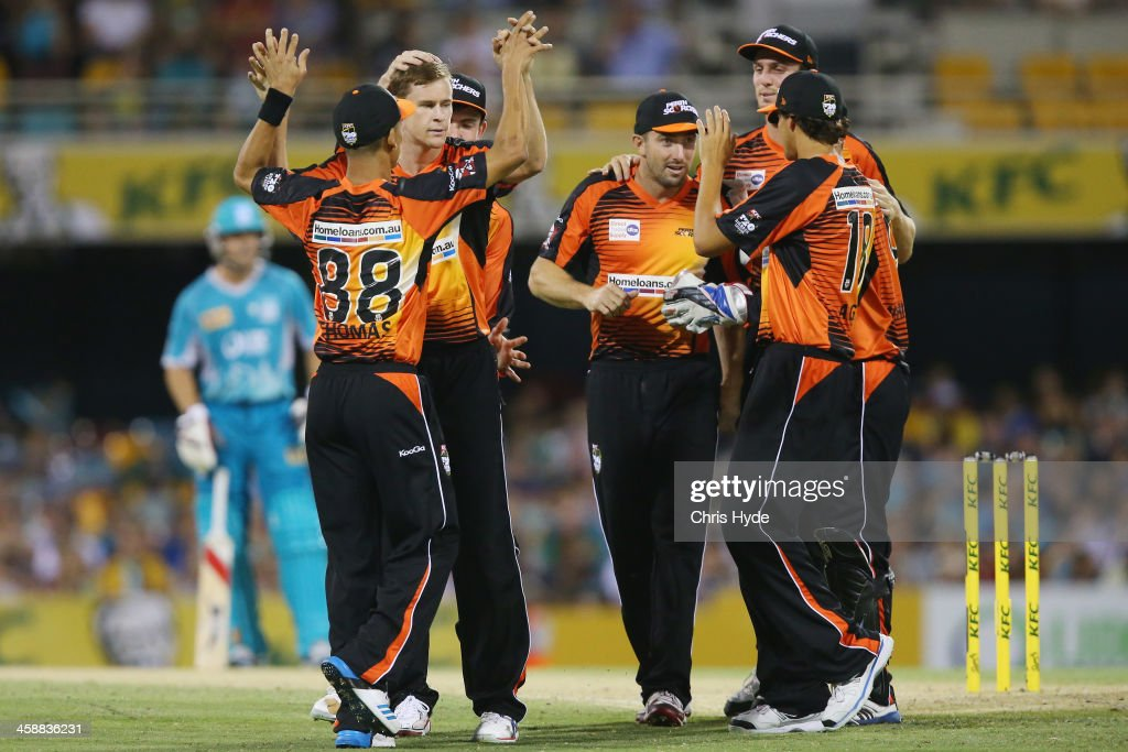 Jason Behrendorff of the Scorchers celebrates with team mates after dismissing Craig Kieswetter of the Heat during the Big Bash League match between the Brisbane Heat and the Perth Scorchers at The Gabba on December 22, 2013 in Brisbane, Australia.