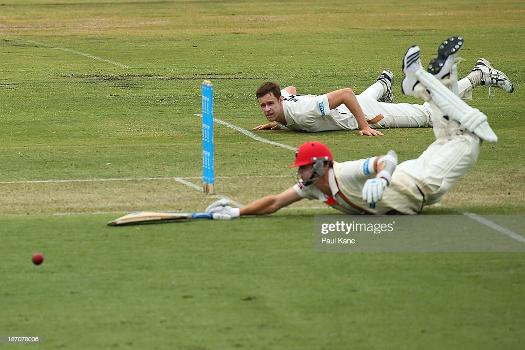 Jason Behrendorff of the Warriors attempts to run out Joe Mennie of the Redbacks during day one of the Sheffield Shield match between the Western Australia Warriors and the South Australia Redbacks at the WACA on November 6, 2013 in Perth, Australia.