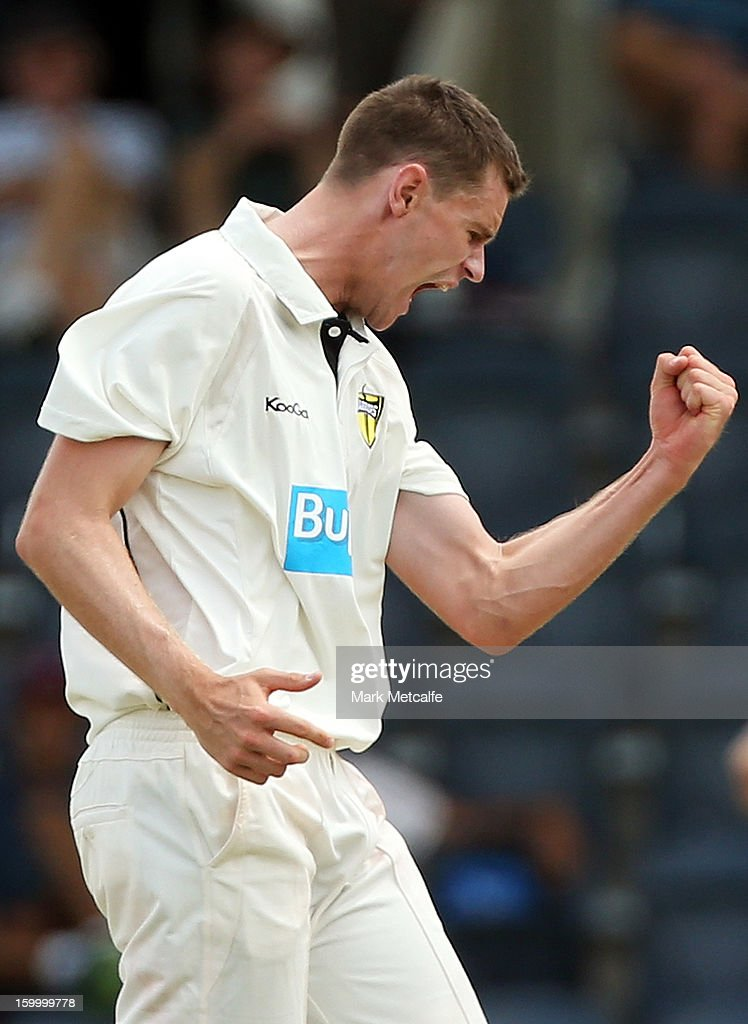Jason Behrendorff of the Warriors celebrates taking the wicket of Ben Rohrer of the Blues during day two of the Sheffield Shield match between the New South Wales Blues and the Western Australia Warriors at Blacktown International Sportspark on January 25, 2013 in Sydney, Australia.