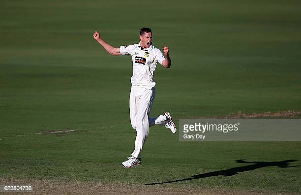 Jason Behrendorff of the Warriors celebrates taking the wicket of Jordan Silk of the Tigers during day one of the Sheffield Shield match between...