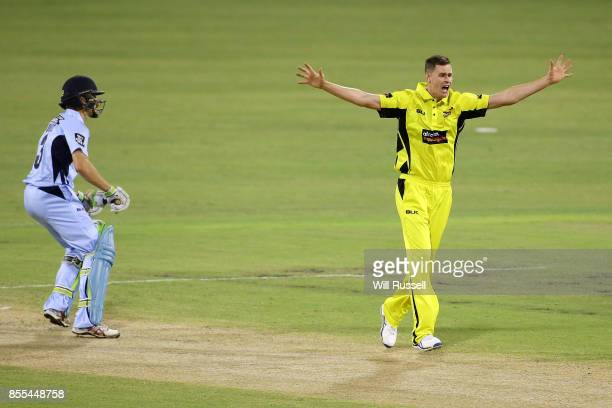 Jason Behrendorff of WA celebrates after taking the wicket of Daniel Hughes of NSW during the JLT One Day Cup match between New South Wales and...