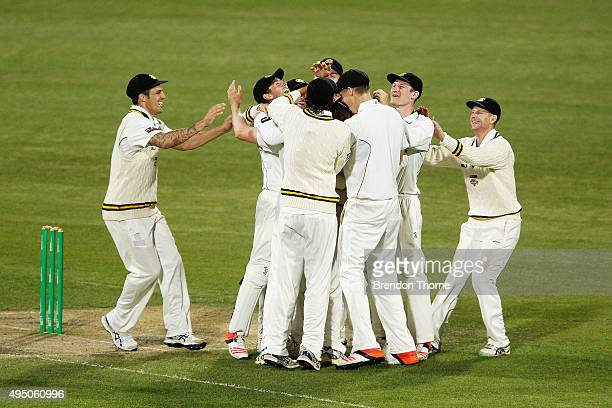Jason Behrendorff of Western Australia celebrates with team mates after claiming the wicket of Jackson Bird of Tasmania during day four of the...