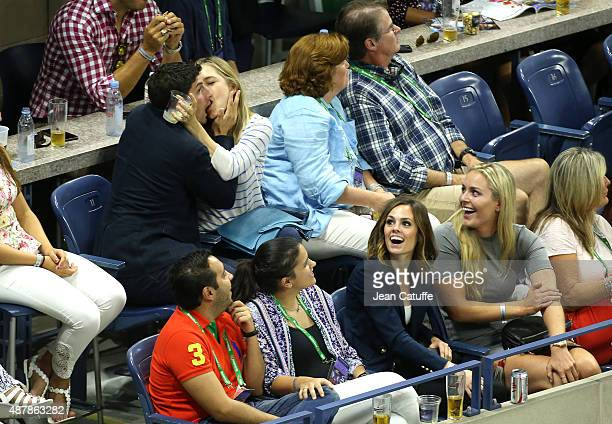 Jason Biggs and his wife Jenny Mollen enjoy the 'kiss cam' while Lindsey Vonn laughs during day twelve of the 2015 US Open at USTA Billie Jean King...