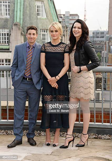 Jason Biggs Taylor Schilling and Laura Prepon attend a photocall to launch season 2 of Netflix exclusive series 'Orange Is The New Black' at the Soho...