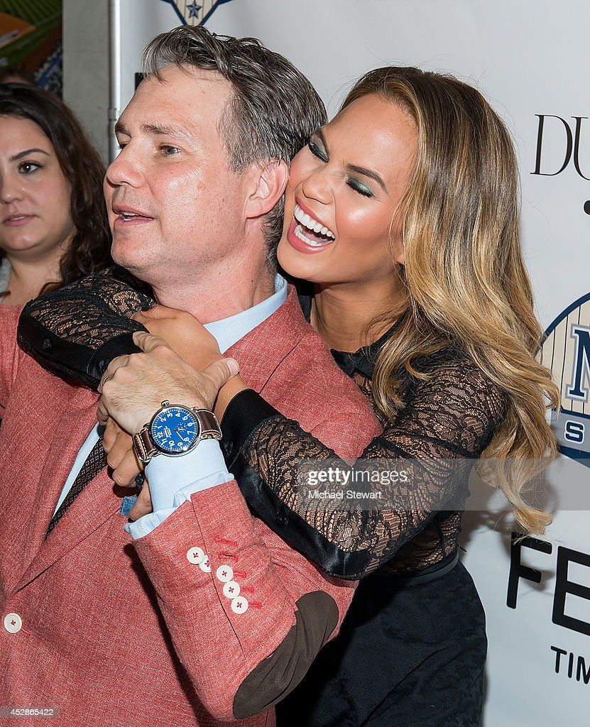 <a gi-track='captionPersonalityLinkClicked' href=/galleries/search?phrase=Jason+Binn&family=editorial&specificpeople=204684 ng-click='$event.stopPropagation()'>Jason Binn</a> (L) and model Chrissy Teigen attend the DuJour celebration of cover star Chrissy Teigen at NYY Steak Manhattan on July 28, 2014 in New York City.