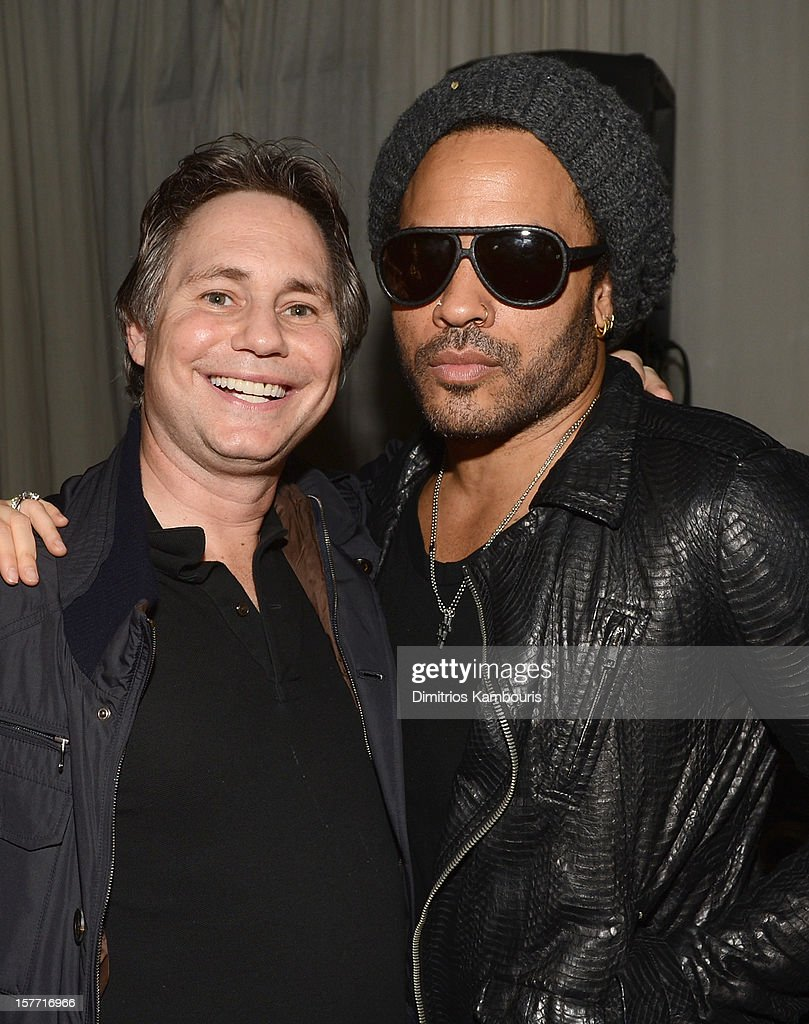 Jason Binn (L) and musician Lenny Kravitz attend a Beachside Barbecue presented by CHANEL hosted by Art.sy Founder Carter Cleveland, Larry Gagosian, Wendi Murdoch, Peter Thiel and Dasha Zhukova at Soho Beach House on December 5, 2012 in Miami Beach, Florida.