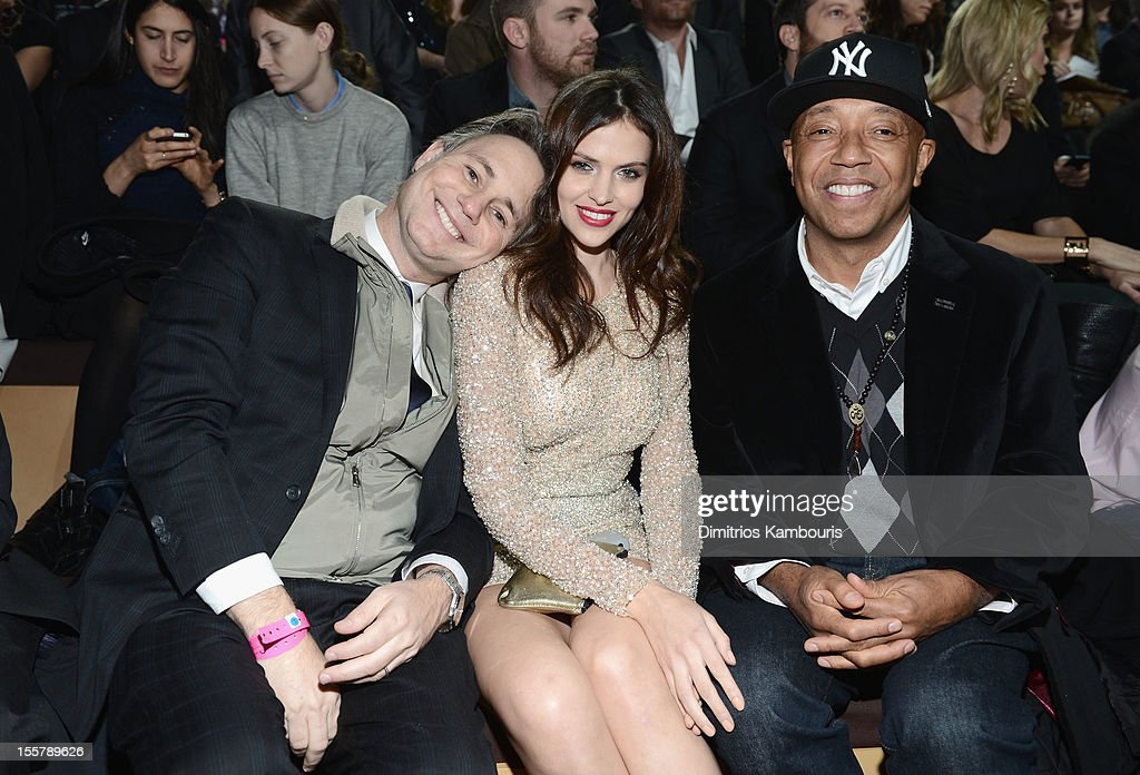 Jason Binn, Hana Nitsche and Russell Simmons attend the 2012 Victoria's Secret Fashion Show at the Lexington Avenue Armory on November 7, 2012 in New York City.