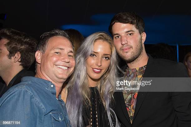 Jason Binn Karen Shiboleth and Just Drew Designer Andrew Warren attend VH1 Save The Music Hamptons Live 2016 on August 27 2016 in Sagaponack New York
