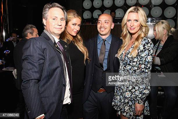 Jason Binn Paris Hilton Thomas Ricotta and Nicky Hilton attend Jason Binn's celebration of Paris Hilton's Spring Cover on DuJour Magazine on April 27...