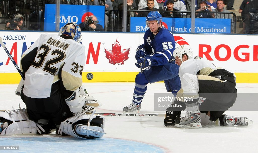 Jason Blake #55 of the Toronto Maple Leafs is stopped by Mathieu Garon #32 of the Pittsburgh Penguins as Rob Scuderi #4 of the Pittsburgh Penguins defends during their NHL game at the Air Canada Centre January 31, 2009 in Toronto, Canada.
