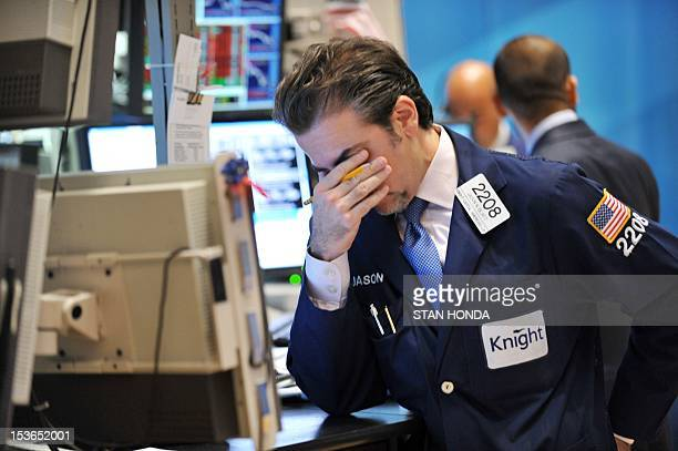 Jason Blatt of Knight Capital Americas LP reacts to down market on the floor of the New York Stock Exchange August 8 2011 US stocks plummeted more...