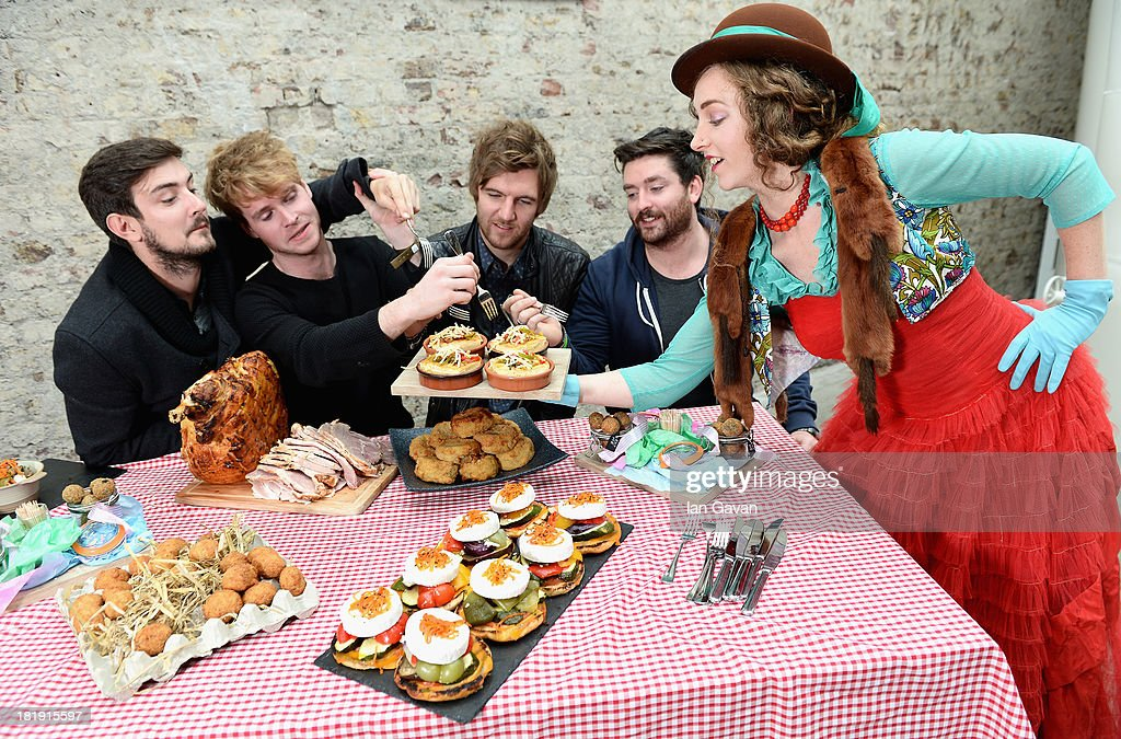 Jason Boland, Stephen Garrigan, Mark Prendergast and Vinny May from Kodaline with Sammy from Queen's of Neon, a multi-dimensional, creative collective at the Guinness Storehouse, where Ireland's talent and creativity across Music, Arts, Food and Sport is being showcased, ahead of the fifth annual Arthur's Day celebrations on September 26, 2013 in Dublin, Ireland. Arthur's Day sees fans come together to experience live music and cultural events in over 500 pubs around Ireland. This year Arthur's Day will spread beyond music to support, promote and showcase Ireland's innovators, artists, poets, writers and culinary experts. It promises to be an extraordinary night, featuring performances from hundreds of home grown acts, rising stars and other internationally renowned artists such as, The Script, James Vincent McMorrow, The Original Rudeboys, Girl Band, Bouts, Le Galaxie, Ham Sandwich, Daley, Manic Street Preachers, Emeli Sande, Janelle Monae, Biffy Clyro, Kodaline, Iggy Azalea and the legendary Bobby Womack. For more information visit www.guinness.com or www.facebook.com/Guinnessireland