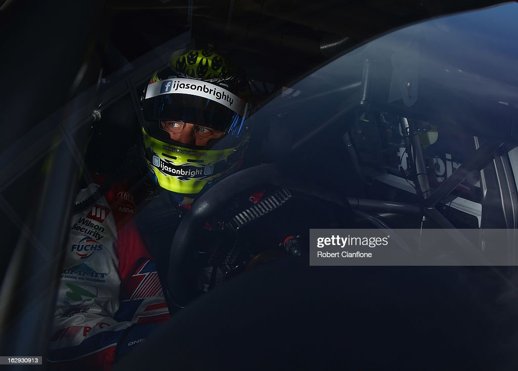 Jason Bright driver of the #8 Team BOC Holden sits in his car during the warm up session prior to race one of the Clipsal 500, which is round one of the V8 Supercar Championship Series, at the Adelaide Street Circuit on March 2, 2013 in Adelaide, Australia.