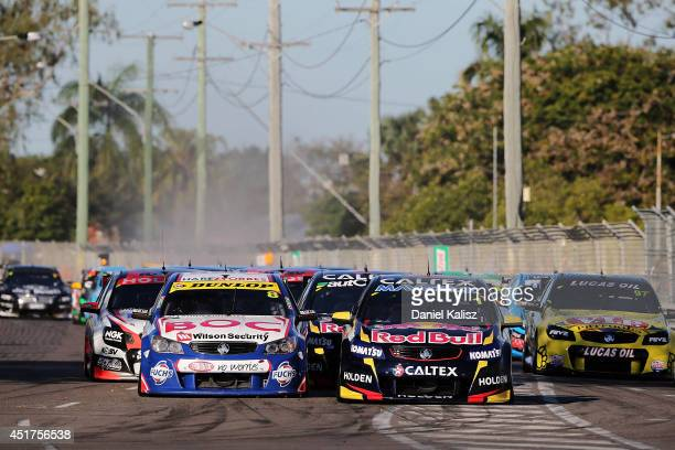 Jason Bright drives the Team BOC Holden battles with Jamie Whincup drives the Red Bull Racing Australia Holden at the start of race 22 of the...