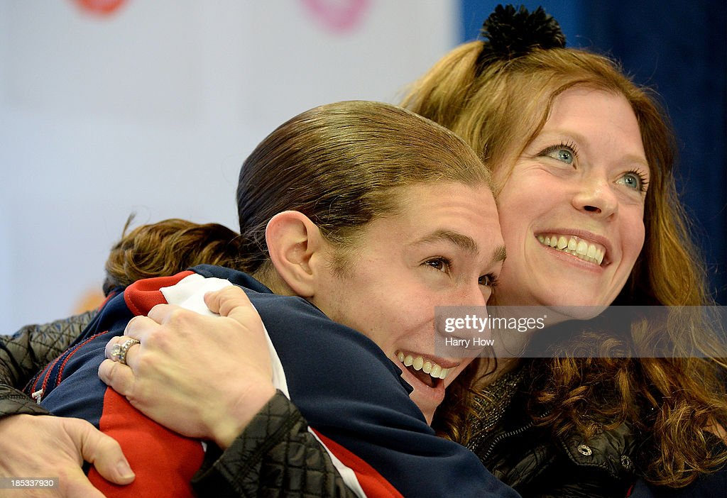 <a gi-track='captionPersonalityLinkClicked' href=/galleries/search?phrase=Jason+Brown+-+Figure+Skater&family=editorial&specificpeople=12450686 ng-click='$event.stopPropagation()'>Jason Brown</a> and coach Kori Ade celebrate their score during the men's short program at Skate America 2013 at Joe Louis Arena on October 18, 2013 in Detroit, Michigan.