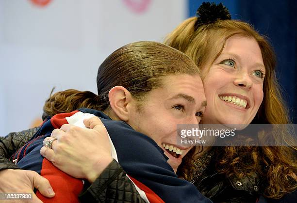 Jason Brown and coach Kori Ade celebrate their score during the men's short program at Skate America 2013 at Joe Louis Arena on October 18 2013 in...