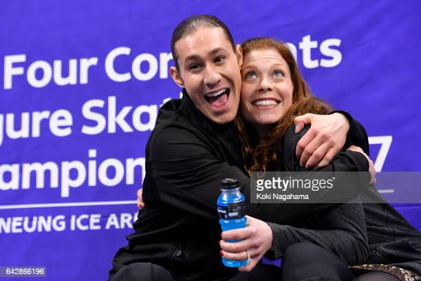 Jason Brown of United States celebrates with his coach Kori Abe at the kiss and cry after the men's free skating during ISU Four Continents Figure...
