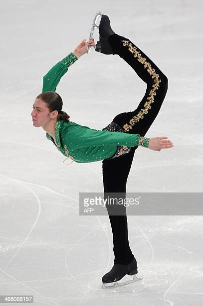 US Jason Brown performs in the Men's Figure Skating Team Free Program at the Iceberg Skating Palace during the Sochi Winter Olympics on February 9...
