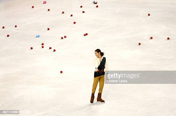 Jason Brown reacts as flowers are thrown on the ice after his routine in the Men's Free Skate Program Competition during day 4 of the 2015 Prudential...
