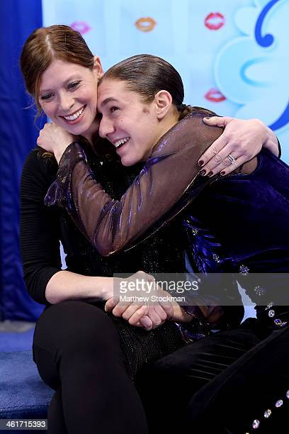 Jason Brown sitting with coach Kori Ade celebrates his score in the kiss and cry after skating in the short program during the Prudential US Figure...