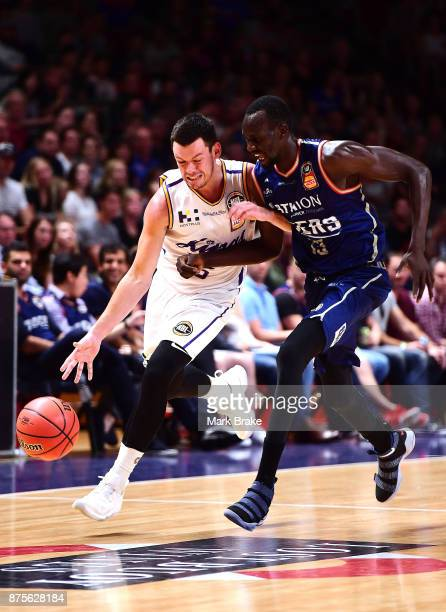 Jason Cadee of Sydney Kings competes with Majok Deng of the 36ers during the round seven NBL match between Adelaide 36ers and the Sydney Kings at...